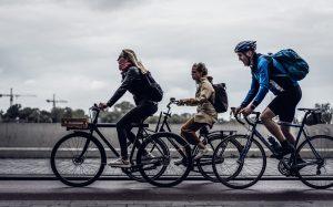 Three cyclists commute