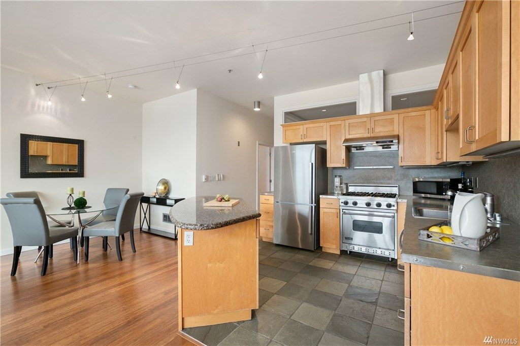 Kitchen, island and dining area