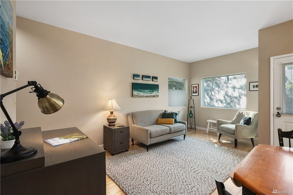 Living room with desk and door