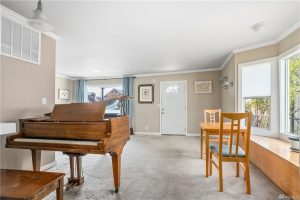 Living room showing a piano