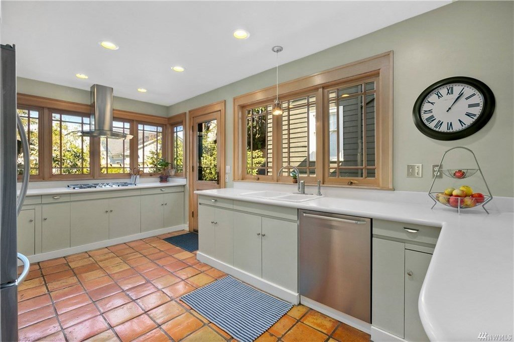 The kitchen has lots of windows and counter space