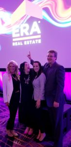 Sheri Lamb, Maria Sims and Jaime Brock with ERA Sunrise Realty Broker, David Moody on ERA IBC 2018 Stage