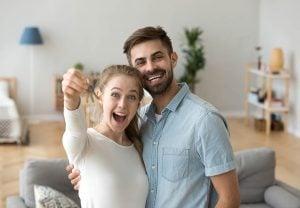 couple celebrating home buying