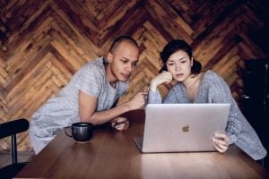 Man and woman sharing laptop