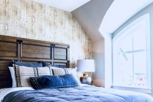 Wooden headboard and blue accent bed