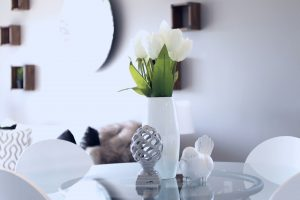 White vase and flowers with assorted accents