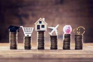 Piles of coins for budgeting big expenses   Raboin Realty