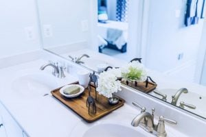 Bathroom staging with flowers and wooden accents