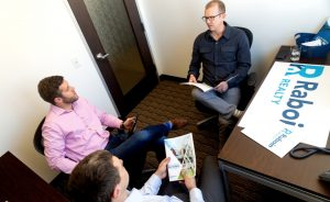 Raboin Realy agents in conversation - Amazon Fulfillment Center Fargo