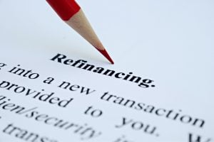 Refinancing definition text with red pencil over