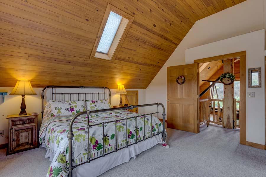 Master bedroom at 31350 Deerwood Ranch Rd, Oak Creek, CO 80467