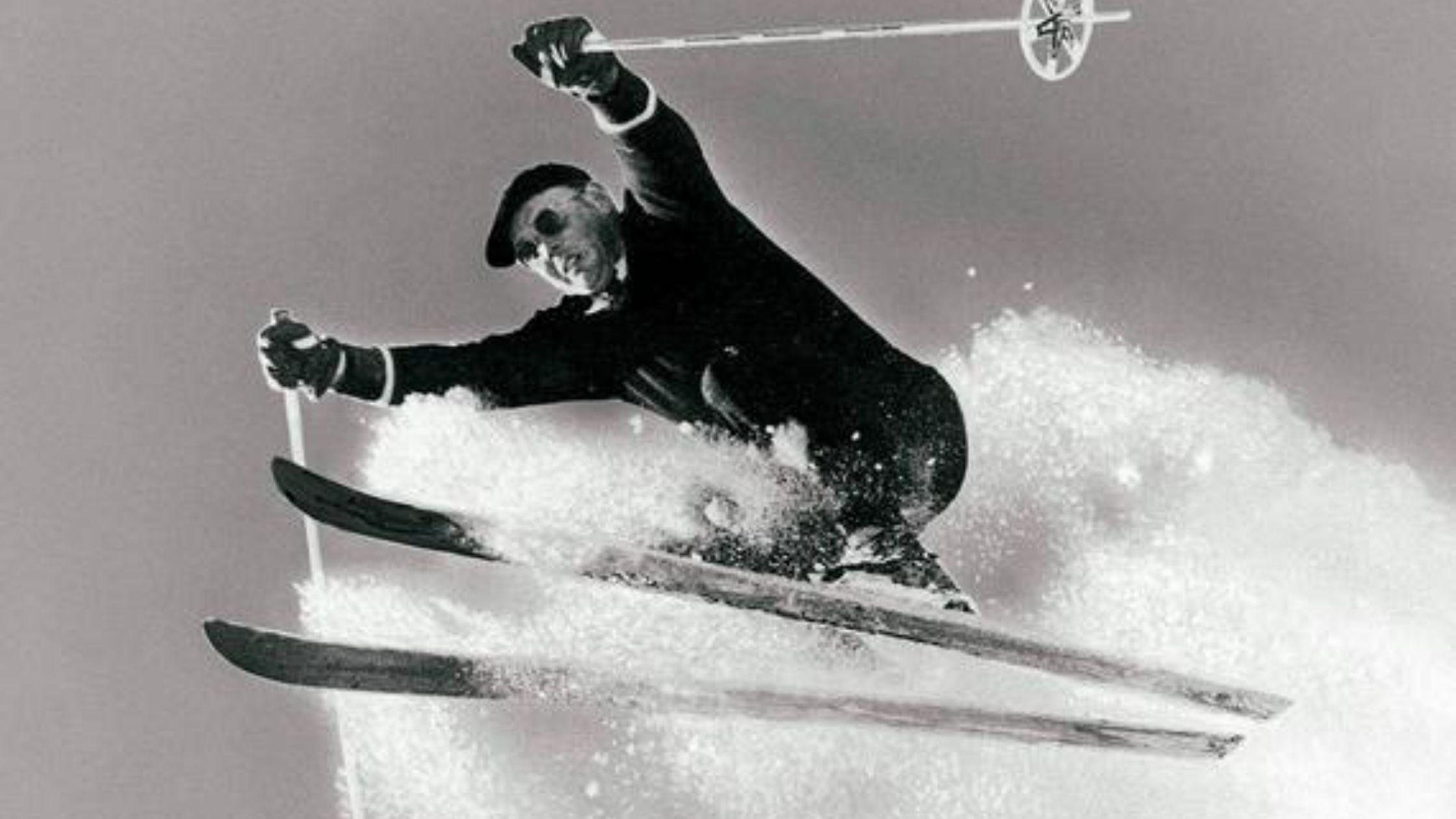 Vintage photo of a man skiing in Mill Ridge neighborhood, former ski resort community.