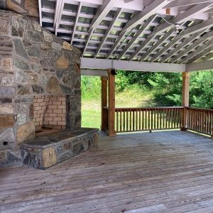 Outdoor living area in Valle Crucis home on Crab Orchard Creek.