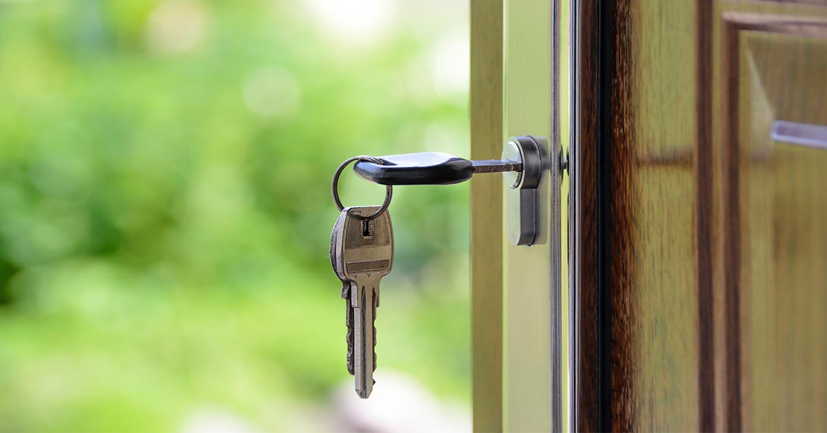 Key unlocked a front door of a new home bought trough a real estate professional.