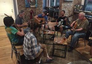 A group of people having a traditional Appalachian North Carolina folk jam session.