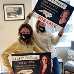 North Carolina Realtor's Susan Stelling and Emily Shack holding for sale signs at 828 Real Estate in Boone, NC.