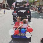 Children in a July Fourth parade on King Street in Downtown Boone, NC.