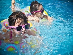 Kids swimming in an Home owner's association pool