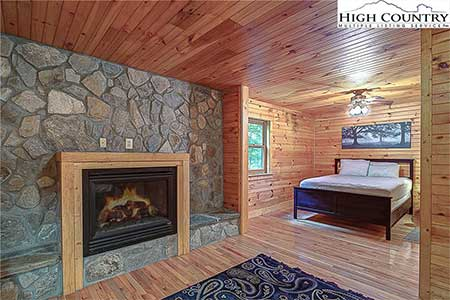 Bedroom with fireplace in 175 Payton Lane a Banner Elk, NC home