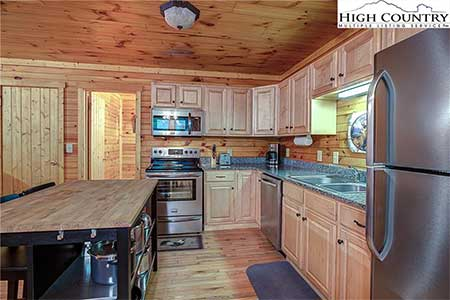 Kitchen with stainless steel appliances in 175 Payton Lane in Banner Elk, NC