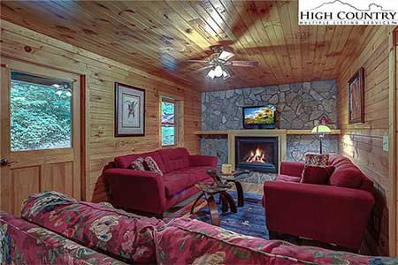 Living room with fireplace in 175 Payton Lane home in Banner Elk, NC