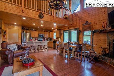 Living area inside 217 New River Landing log cabin in Crumpler, NC