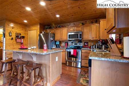 Log cabin kitchen inside 271 New River Landing log cabin in Crumpler, NC