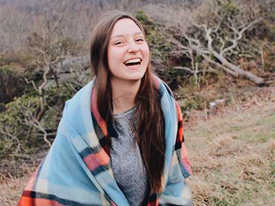 Girl posing for photos on the Blue Ridge Parkway