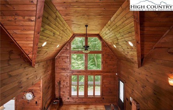 Grand foyer with high ceilings in Wren Cove log cabin house