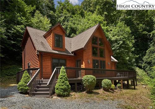 Log cabin home at 202 Wren Cove