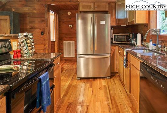 Kitchen inside log cabin home.