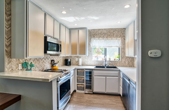 Kitchen with new tiled backsplash.