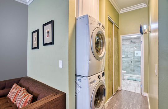 Laundry and second closet in master bedroom.
