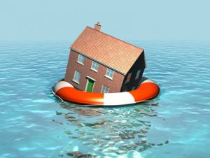 Global warming, house on a lifebelt, rising sea levels, flooding