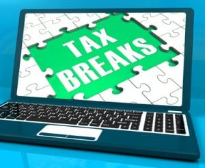 Tax Breaks On Laptop Showing Internet Taxing And Online Payments