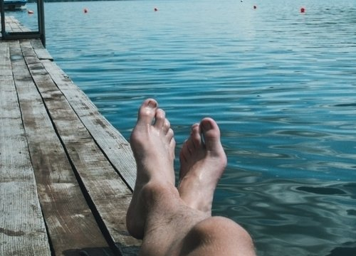 Man relaxing on a dock between the lakes in Wylie
