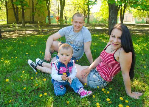 Happy young family mom, dad, son in a Dallas park