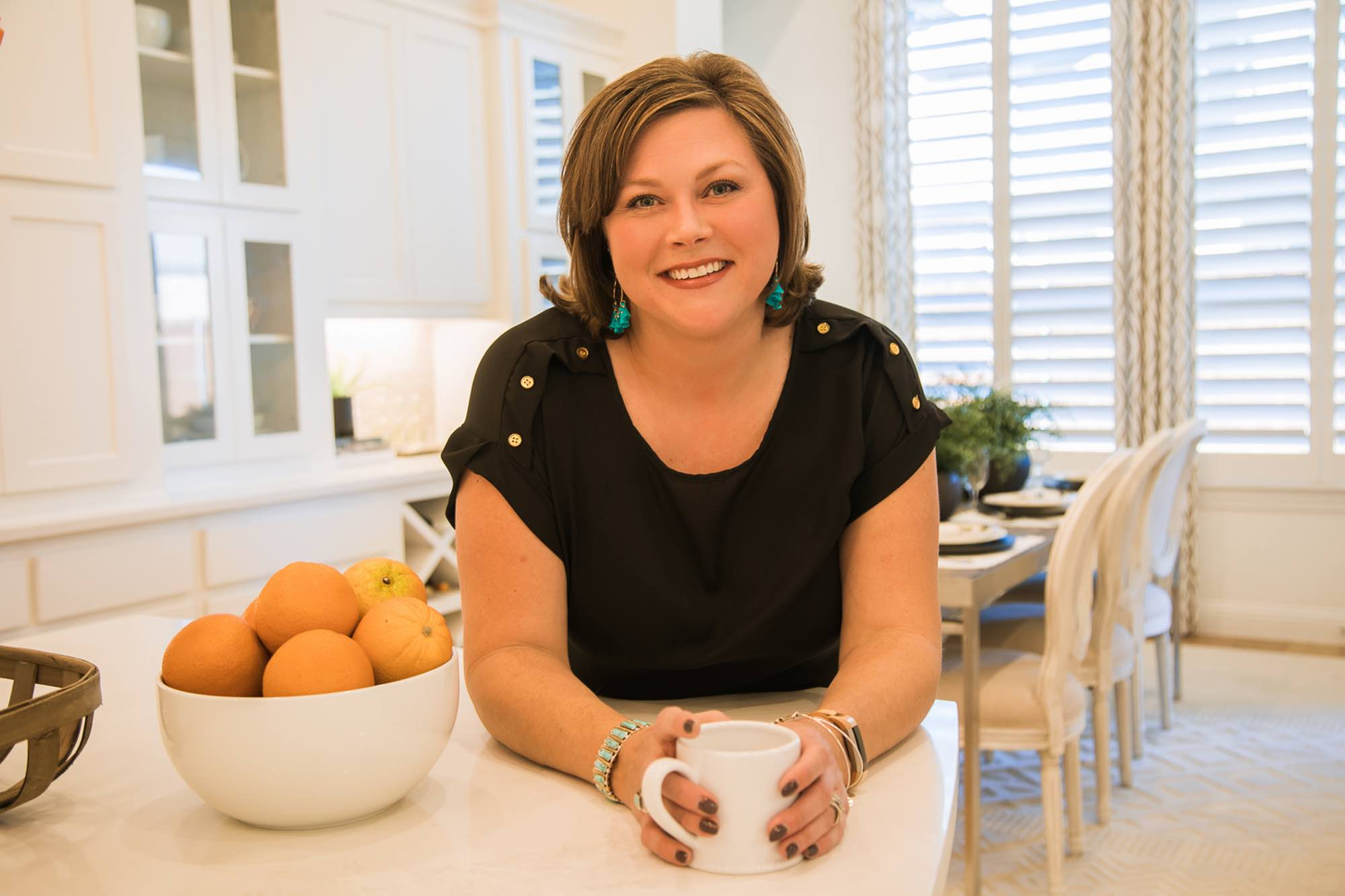 Amy Beyer, real estate pro, in kitchen with coffee