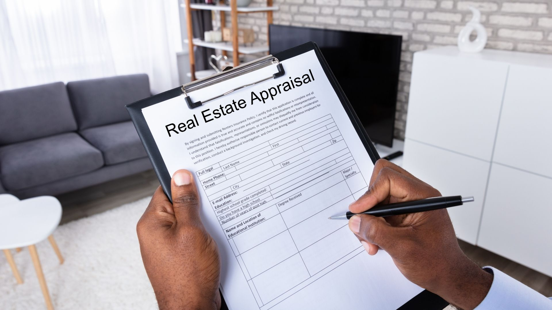 Appraiser inspecting a home to determine value