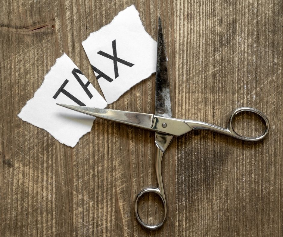 Scissors cutting taxes Homestead exemption cuts property taxes