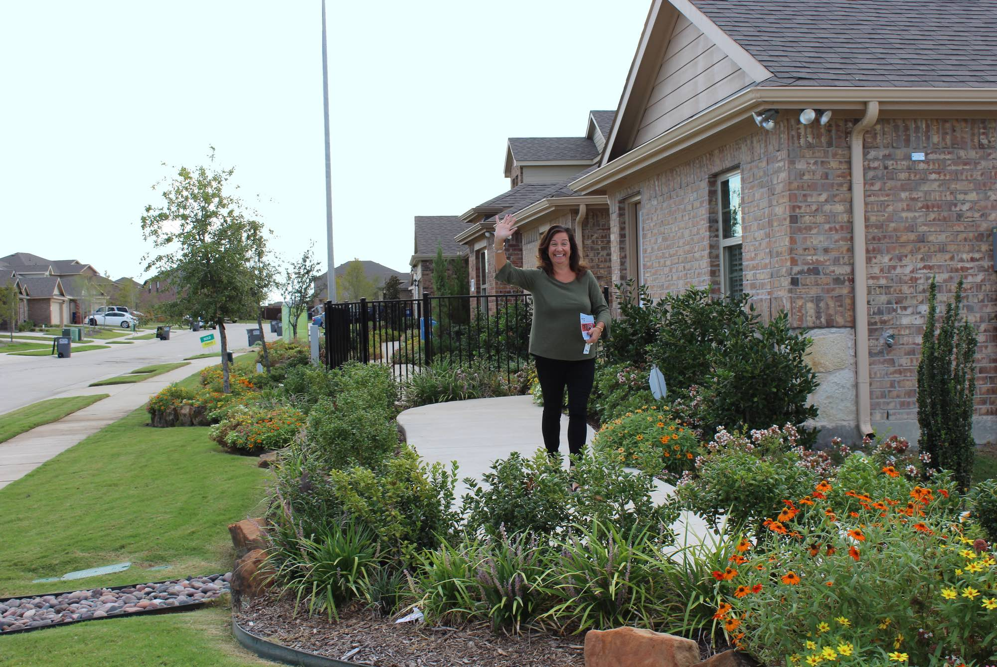 Agent meeting clients at the builder model home