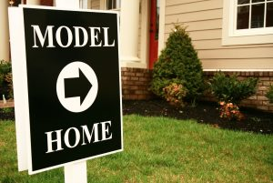 Model home sign - the person who is at the model home is working for the builder.