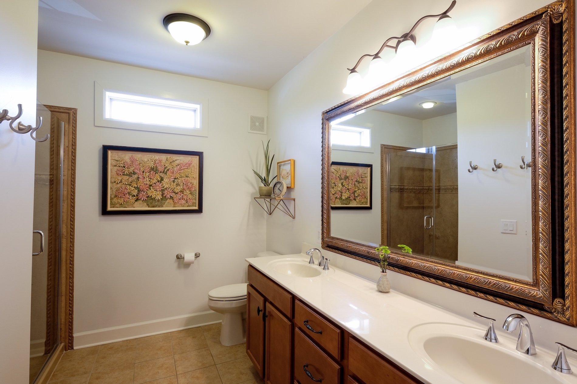 Master en suite, glass shower, his and her vanity,