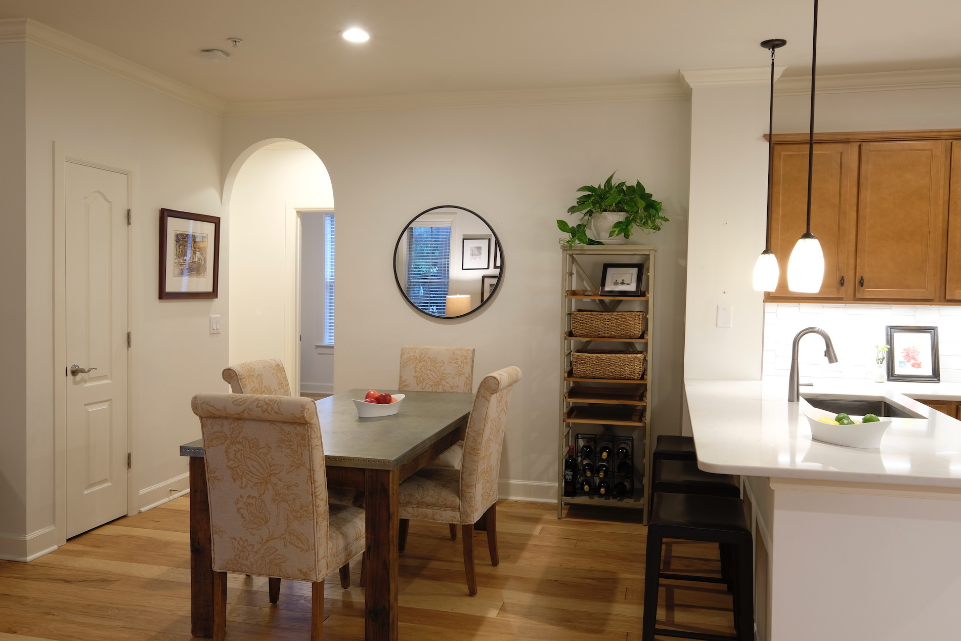 Sherwin Williams white paint, industrial dining table, house plant, white quartz counters