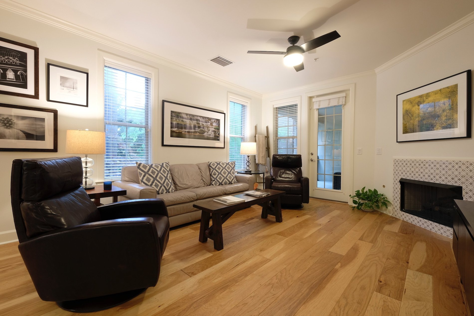 Sherwin Williams white paint, natural hickory hardwood floors, ceiling fan, painted tile fireplace