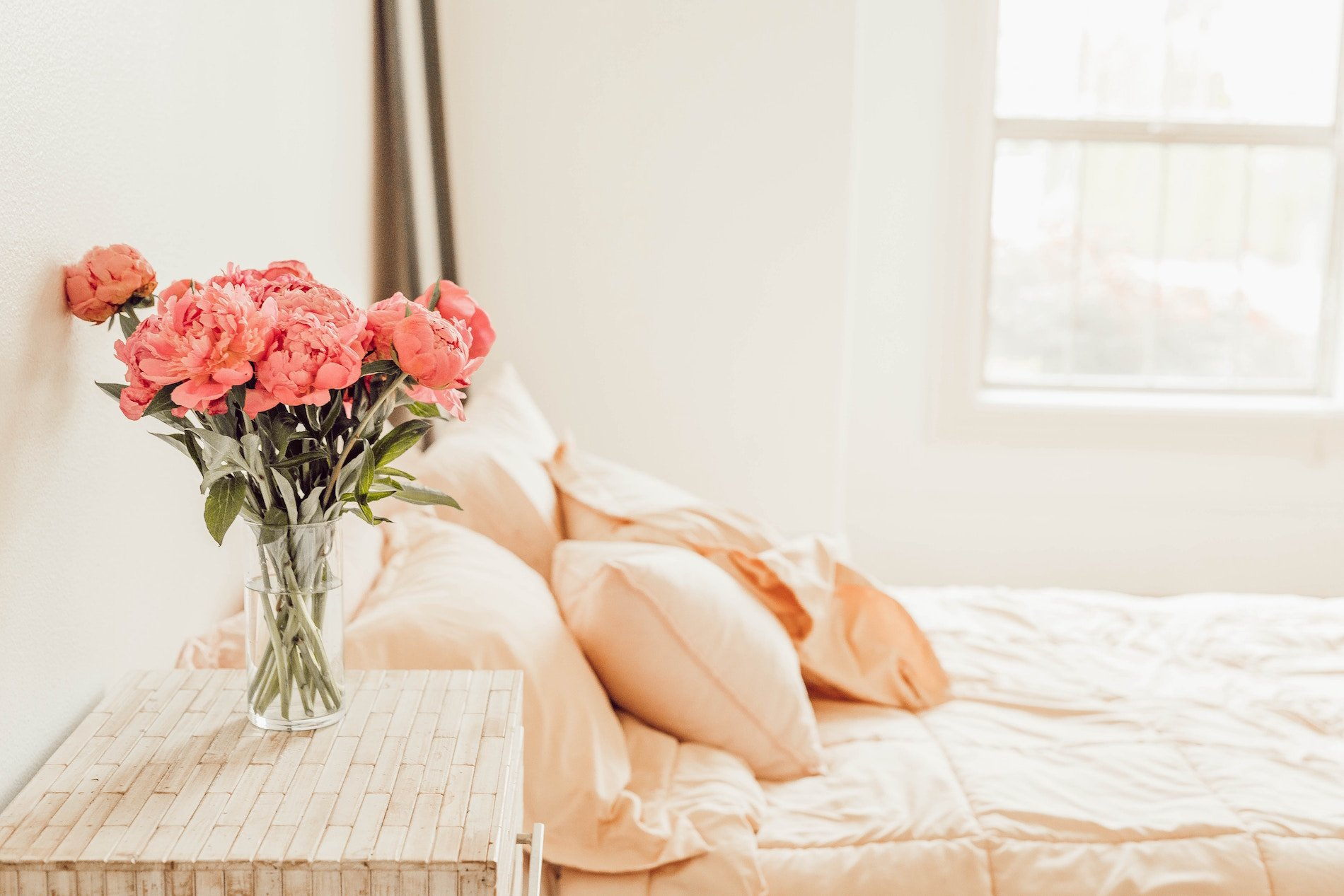 Fresh flowers, clean linens, natural light in guest room