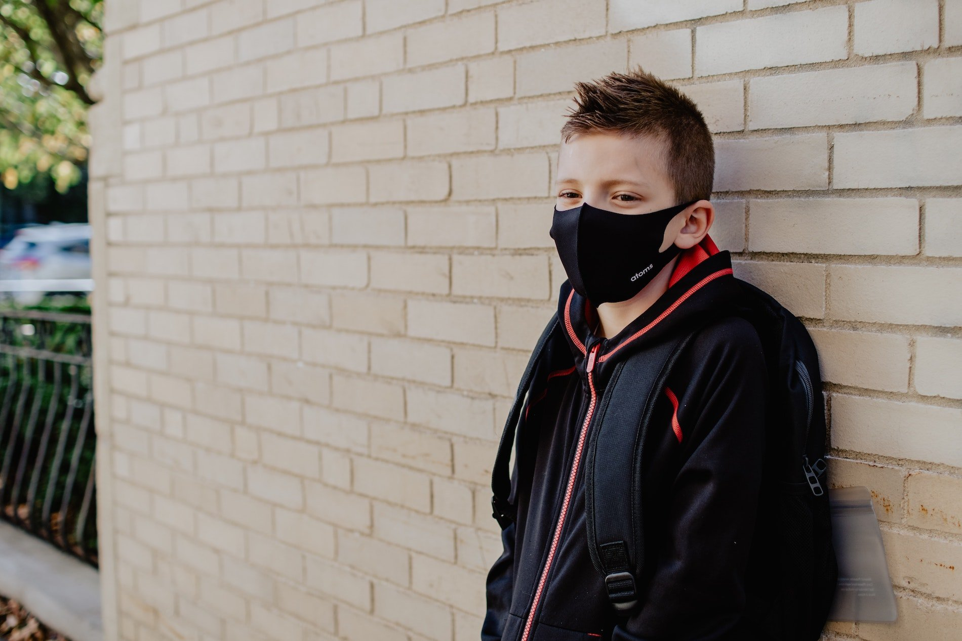 student wearing mask and coat