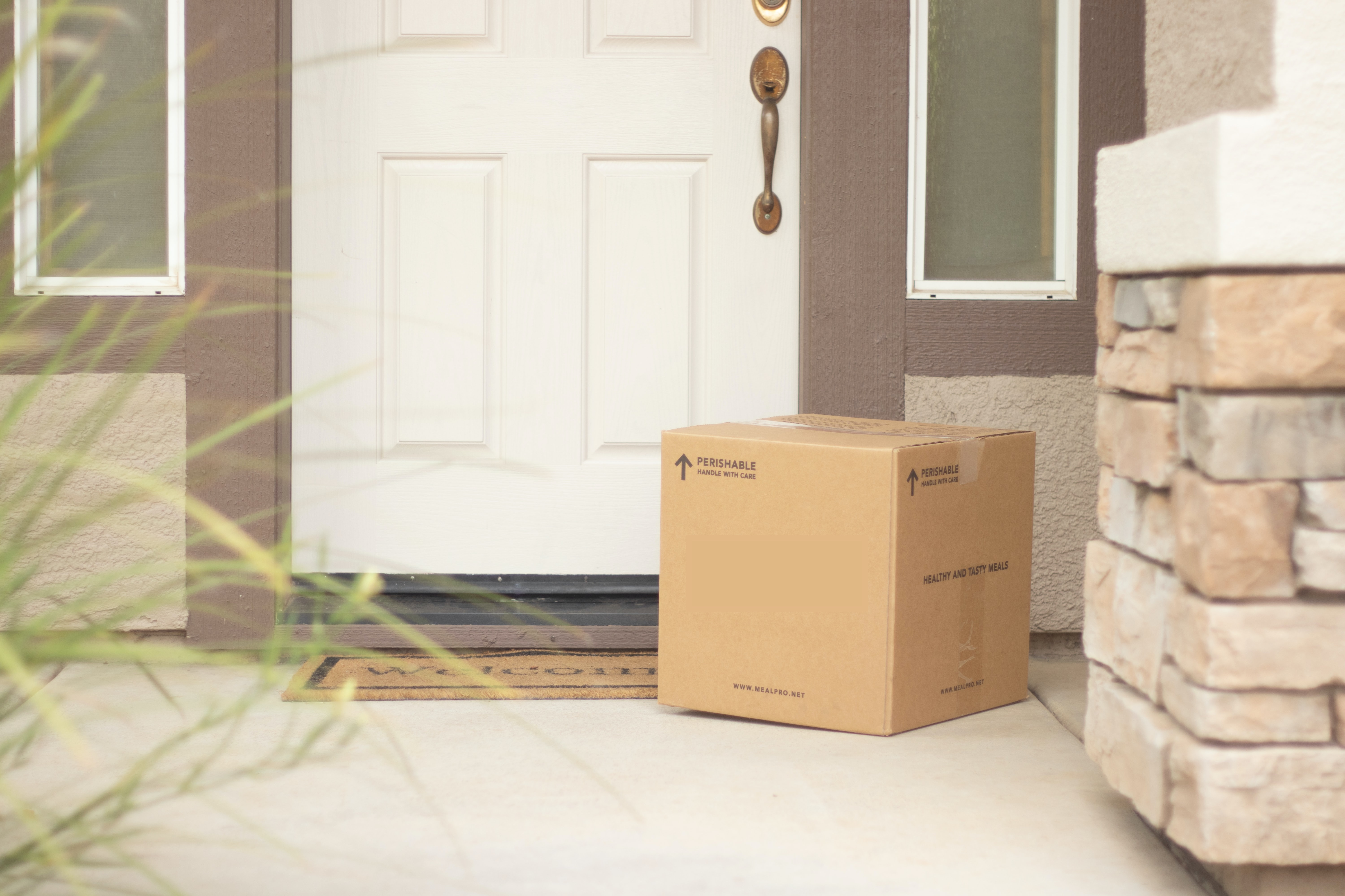 cardboard box package delivery on porch